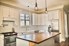 Traditional Kitchen with High ceiling, Frigidaire Gallery 30'' Slide-In Electric Range, Limestone Tile, Flush, Farmhouse Sink