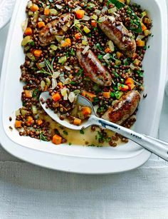 Sausage and lentil traybake 1 tbsp olive oil 8 sausages 1 large onion 2 sticks celery 1 large carrot 3 garlic cloves 2 x tins Merchant Gourmet Puy lentils, drained white wine or chicken stock 1 bay leaf 2 sprigs rosemary tbsp flat-leaf parsley, chopped Sausage Recipes, Pork Recipes, Cooking Recipes, Healthy Recipes, Baked Sausage, Budget Recipes, Cooking Ideas, Yummy Recipes, Salad Recipes