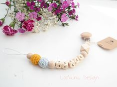 """16 To se mi líbí, 1 komentářů – Lookchic Design (@lookchic_design) na Instagramu: """"Second part of babyshower gift. Dummy chain with name with mustard and baby blue colors. What do…"""""""