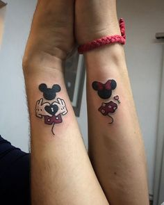 Prove your endless love to your partner by getting matching Disney tattoos. Whether it's of your favorite characters or a famous quote, any ink is magical. Matching Disney Tattoos, Disney Couple Tattoos, Mickey And Minnie Tattoos, Mickey Tattoo, Mickey And Minnie Kissing, Mickey E Minie, Disney Couples, Matching Couples, Best Couple Tattoos