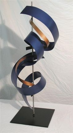 Modern metal sculpture - metallic blue, copper, and stainless steel