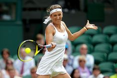 Victoria Azarenka Photos - Victoria Azarenka of Belarus returns a shot during her third round match against Daniela Hantuchova of Slovakia on Day Five of the Wimbledon Lawn Tennis Championships at the All England Lawn Tennis and Croquet Club on June 24, 2011 in London, England. - The Championships - Wimbledon 2011: Day Five