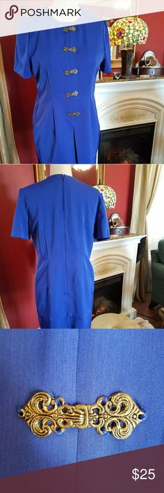 One Piece Suit Royal Blue Dress has appearance of a two piece suit. Pretty gold pieces appear to be buttons down the front but there is a zipper in the back. Brand is Whirlaway Frocks. Material is polyester. Vintage Dresses Midi