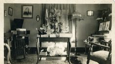 The living room in my grandparents' home probably in the early 1900's.  I remember the old victrola in the corner - it was in their basement when I was a kid.  And I banged on that piano many, many times.