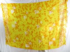 monocolor yellow sarong hand stamped prints with leaves - http://www.wholesalesarong.com/blog/monocolor-yellow-sarong-hand-stamped-prints-with-leaves/