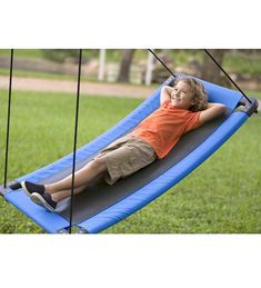 SkyCurve Platform Swing - There's always room for more fun—and more friends—on this curved platform swing that supports up to four kids. The platform's slight curvature adds an extra dimension of excitement to the super-sized swinging motion. Sit, stand, or lie on the comfy polypropylene fabric mat, hold on to the thick, durable ropes, and enjoy the ride!