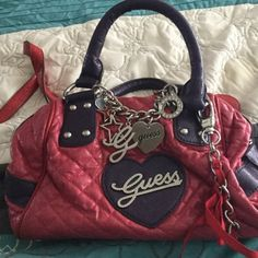 Pink & purple guess purse Pink & purple Guess purse! N very good condition... Only wore it twice  Guess Bags