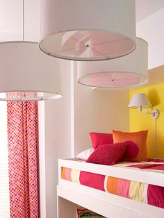 A Timeless Girls' Room for Two:   Smart design and savvy storage make this tiny room in a New York City loft suitable for two kiddos. The Light Solution:   In a shared room, spaces need to be multifunctional, and top bunks can pose a major dilemma with lighting. Consider installing a reading sconce into the wall. To brighten up the whole room, pendant lights are also functional. They can visually lower a high ceiling while adding extra flair to the room's decor.