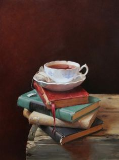 Images of tea/coffee cups on or next to books: Sexy to me, for it stirs the loins of my mind. Thoughts race at the mere glimpse, like a heart when stirred by desire! Yes, my passion awakens with every vision like this.