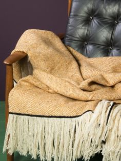 WOLFEN GErMANY.  Nice blanket made of pure wool, woven in England, with long fringe.