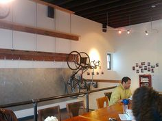 Wall-mounted bike rack at the Actual Cafe in Oakland