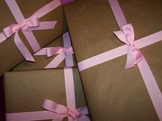 Sometimes, I make things look really pretty for cheap - part of Sister's baby shower gift wrapped in brown Kraft paper and pink grosgrain ribbon
