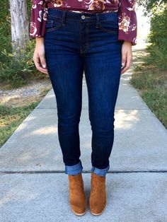 Dark wash skinny jeans are a closet staple for every girl, and these jeans are perfection. Gorgeous dark wash, soft whiskering, mid-rise, and a soft, stretchy skinny fit. Zipper and button closure, fi