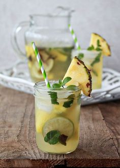 Pineapple Mojito Sangria (3 medium limes Small bunch mint 1/3 cup sugar 1 small fresh pineapple 750 ml bottle white wine 1/2 cup white rum 3/4 cup pineapple juice 4 cups lemon-lime soda) by aftr