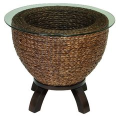 get a planter stand, and dust off the end tables in the shed.  Woven banana leaf side end table.Product: End table  Construction Material: Wood, banana leaf and glass  C...