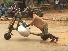home made bike... Ugandan man powering his way up the hill with his load very impressive credit Sal Roux