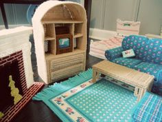 """Not really into the idea of having all plastic canvas furniture for the dollhouse, but I love the idea of a custom designed """"rug"""" made of it! And maybe that fireplace!"""