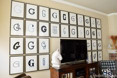 Great idea for a gallery wall - this is a little much for me, but I'd love to do a mini version with Gold letters in black frames