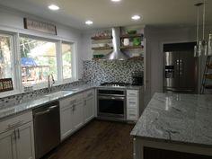 Kitchen Remodel.  Viscount White Granite.  Floating shelves.  Stainless appliances.