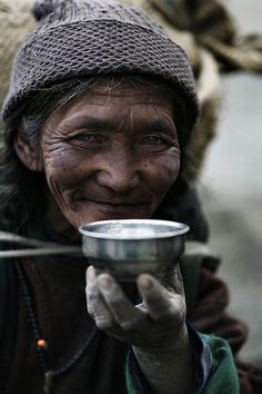 : : people : : Tibetan woman drinking a cup of regenerating Tibetan butter tea...