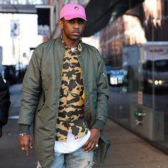 Rapper Fabolous - who also posts about menswear and fashion on his blog @myfabolouslife - mixed pink and camo at the Public School show. Photo by @gastrochic #streetstyle #fashion #NYFWM