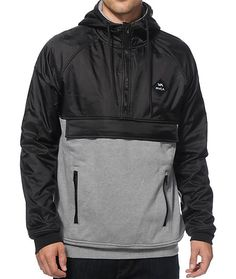 Add a throwback anorak style to your wardrobe with a black quarter zip ripstop nylon upper accented by a grey knit lower body and a soft fleece lining for comfort.