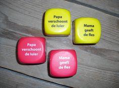 Een dobbelsteen met een grappige tekst. Leuk om cadeau te doen aan de aanstaande papa of mama.