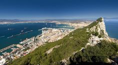 Explore #384 on Wednesday, November 18, 2009 This panoramic landscape from the top of the Rock Of Gibraltar is made up of six portrait style images carefully pieced & stitched together to produce this rather breathtaking viewpoint overlooking the Strait of Gibraltar. The shot is looking across to mainland Spain, to my left out of shot North African coastline is easily visible separated 7.7 nautical miles of ocean at the strait's narrowest point. Look closely bottom right & you can see my…