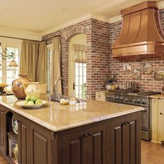 Brick and copper kitchen - Idea House Kitchen Design Ideas - Southern Living Exposed brick + doorway arch
