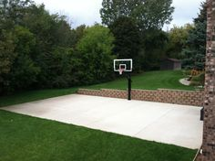 In the middle there's Pro Dunk Platinum Basketball System on the concrete slab.