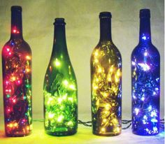 Re-use your alcohol bottles! Collect desired amount and coloured empty bottles. Buy new or get your old christmas lights. Insert christmas lights in he bottles. Empty Wine Bottles, Lighted Wine Bottles, Bottle Lights, Liquor Bottles, Bottle Lamps, Alcohol Bottles, Wine Bottle Crafts, Cool Diy, Easy Diy