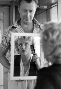 Marilyn Monroe - for some reason, I find this picture beautifully sad, looks as though she's looking up to him for approval. What a tragic loss she was   :(