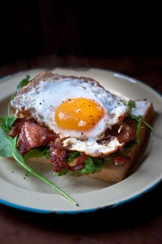 Pine needle duck egg and bacon sandwich. Intrigued by the pine needle eggs...