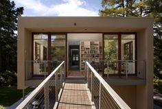 Contemporary Exterior of Home with Wood casement, Bridge entry, Built-in bookshelf, Open concept, Wood bridge, Natural light