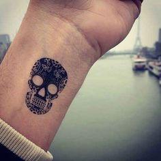 tiny skull tattoos
