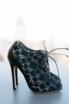 These black booties have won our hearts with the subtle lacy pattern and the laces up the front.   - HarpersBAZAAR.com