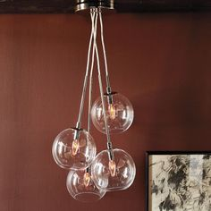"A fun, new take on west elm's popular Globe Pendant. Four glass spheres form a modern quartet, adding bold visual impact over seating, table or bed.    • Polished nickel; clear glass.  • Four glass globes, suspended in staggered heights.  • 7.8""diam. x 36""h.  • Uses (4) type-B bulbs (not included).  • Assembly required.  • Hardwired. Professional installation recommended.  • UL listed.  • Wipe clean.  • Imported."
