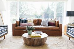 layering rugs cowhide over jute Studio McGee... LOVE this setup and the layered rugs of course!