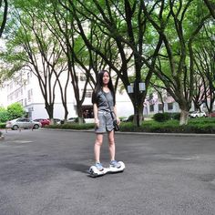 Cool girl is riding N1 Mini Smart 2 Wheel Self Balancing Electric Skateboard Hands Free Airboard Hoverboard Scooter