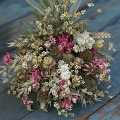 Rustic dried flower wedding bouquet containing, Larkspur, Scabiosa Seed Pods, Nigella Seed Pods, Daisies, Oats, Wheat..