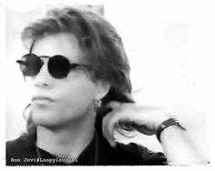 "Jon Bon Jovi circa 1993. @loopyloujovi | Tumblr -  ""Just playing with my hair"""