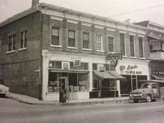 Stanford, Kentucky.... corner of Depot St and Main, 1950s Pence-Gilliland Insurance, Russell Jewelry, Speaks Flowers and Self-Service Laundry..
