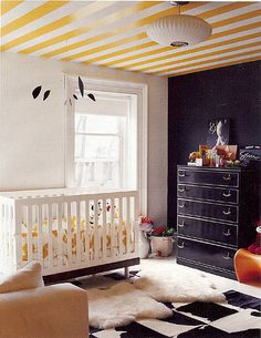 Domino Magazine | Flickr - Photo Sharing! Love the rug, chalkboard wall, mobile.  What a cute room.
