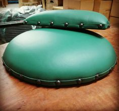 Step 3: Nothing beats the precision of hand made quality work. Commercial grade leather in this earthy green colour, paired with leather trim and tack detail. The upholstered seats and backrests are ready for installation! www.zenporium.com  #customdesign #barstools #industrialbarstool #customstools #customfurniture  #industrialdesign #commercialinteriors #itsallinthedetails #upholstery #madeincanada #youdreamitwebuildit #Zenporium #shoponline Industrial Bar Stools, Industrial Design, Commercial Interiors, Custom Furniture, Tack, Green Colors, Earthy, Beats, Upholstery