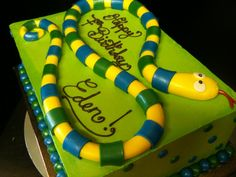 Here's a cute quarter sheet green buttercream cake with a fondant snakie on top This one was for a cute little girl named Eden who was just turning seven and loves snakes! When I heard this I asked. 7th Birthday, Birthday Cake, Birthday Ideas, Cute Little Girl Names, Snake Cakes, Slab Cake, Reptile Party, Kids Sheets, Snake Design