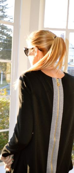 Black dress, grey stripe, exposed gold zipper :: long blonde ponytail