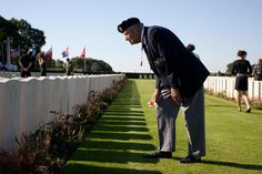 Canadian Dieppe Veteran Ray Gilbert reads the head stones of Canadians who died in the Dieppe Raid, in the Dieppe Canadian War Cemetery. Download High Resolution