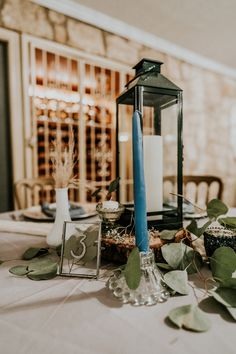 Green Lantern, Glass Candlestick Holder, Wood Stump, Table Number, Milk Jar, Green Votive  P.C. Misty Mclendon Photography Texas Hill Country, Tree Lighting, Twinkle Lights, Wedding Venues, Reception, Candles, Table Decorations, Pictures, Corning Glass