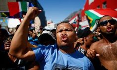 Protesters march in Pretoria, South Africa, calling for President Zuma to step down.