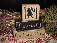Laundry Gathers Here Wood Sign Shelf Sitter Blocks Primitive Country Rustic Home Decor. $23.95 USD, via Etsy.